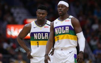 NEW ORLEANS, LOUISIANA - FEBRUARY 04: Zion Williamson #1 of the New Orleans Pelicans and Jrue Holiday #11 react against the Milwaukee Bucks during a game at the Smoothie King Center on February 04, 2020 in New Orleans, Louisiana. NOTE TO USER: User expressly acknowledges and agrees that, by downloading and or using this Photograph, user is consenting to the terms and conditions of the Getty Images License Agreement. (Photo by Jonathan Bachman/Getty Images)
