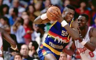 LOS ANGELES - 1991:  Dikembe Mutombo #55 of the Denver Nuggets drives to the basket against the Los Angeles Clippers during an NBA game in 1991 at the Los Angeles Memorial Sports Arena in Los Angeles, California.  NOTE TO USER: User expressly acknowledges and agrees that, by downloading and/or using this Photograph, user is consenting to the terms and conditions of the Getty Images License Agreement.  Mandatory Copyright Notice: Copyright 1991 NBAE (Photo by Jon SooHoo/NBAE via Getty Images) *** Local Caption *** Dikembe Mutombo