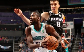 CHARLOTTE, NC - DECEMBER 17: Michael Kidd-Gilchrist #14 of the Charlotte Hornets drives to the basket against the Sacramento Kings on December 17, 2019 at Spectrum Center in Charlotte, North Carolina. NOTE TO USER: User expressly acknowledges and agrees that, by downloading and or using this photograph, User is consenting to the terms and conditions of the Getty Images License Agreement.  Mandatory Copyright Notice:  Copyright 2019 NBAE (Photo by Kent Smith/NBAE via Getty Images)