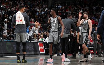 BROOKLYN, NY - FEBRUARY 12: Timothe Luwawu-Cabarrot #9, and Caris LeVert #22 of the Brooklyn Nets hi-five each other during the game against the Toronto Raptors on February 12, 2020 at Barclays Center in Brooklyn, New York. NOTE TO USER: User expressly acknowledges and agrees that, by downloading and or using this Photograph, user is consenting to the terms and conditions of the Getty Images License Agreement. Mandatory Copyright Notice: Copyright 2020 NBAE (Photo by Nathaniel S. Butler/NBAE via Getty Images)