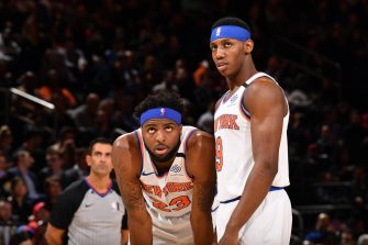 NEW YORK, NY - FEBRUARY 12: Mitchell Robinson #23 and RJ Barrett #9 of the New York Knicks look on during the game against the Washington Wizards on February 12, 2020 at Madison Square Garden in New York City, New York.  NOTE TO USER: User expressly acknowledges and agrees that, by downloading and or using this photograph, User is consenting to the terms and conditions of the Getty Images License Agreement. Mandatory Copyright Notice: Copyright 2020 NBAE  (Photo by Jesse D. Garrabrant/NBAE via Getty Images)