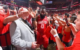 HOUSTON, TX - MAY 4 : James Harden #13 of the Houston Rockets high fives fans after  Game Three of the Western Conference SemiFinals of the 2019 NBA Playoffs against the Golden State Warriors on May 4, 2019 at the Toyota Center in Houston, Texas. NOTE TO USER: User expressly acknowledges and agrees that, by downloading and or using this photograph, User is consenting to the terms and conditions of the Getty Images License Agreement. Mandatory Copyright Notice: Copyright 2019 NBAE (Photo by Bill Baptist/NBAE via Getty Images)