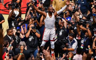 MIAMI, FL - APRIL 09: Dwyane Wade #3 of the Miami Heat runs on top of the scorers table to thank the fans after the final regular season home game of his career against the Philadelphia 76ers at American Airlines Arena on April 09, 2019 in Miami, Florida. NOTE TO USER: User expressly acknowledges and agrees that, by downloading and or using this photograph, User is consenting to the terms and conditions of the Getty Images License Agreement.  (Photo by Mark Brown/Getty Images)
