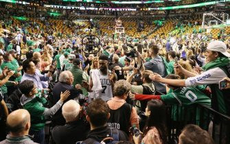 BOSTON, MA - MAY 23:  Jaylen Brown #7 of the Boston Celtics high fives fans after defeating the Cleveland Cavaliers 96-83 in Game Five of the 2018 NBA Eastern Conference Finals at TD Garden on May 23, 2018 in Boston, Massachusetts. NOTE TO USER: User expressly acknowledges and agrees that, by downloading and or using this photograph, User is consenting to the terms and conditions of the Getty Images License Agreement.  (Photo by Maddie Meyer/Getty Images)