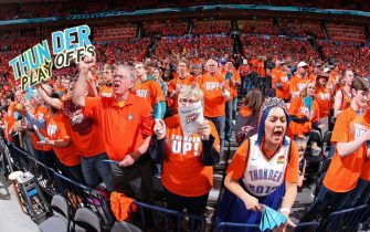 OKLAHOMA CITY, OK - APRIL 19: Fans of the Oklahoma City Thunder cheer during the game against the Portland Trail Blazers during Game Three of Round One of the 2019 NBA Playoffs on April 19, 2019 at Chesapeake Energy Arena in Oklahoma City, Oklahoma. NOTE TO USER: User expressly acknowledges and agrees that, by downloading and/or using this photograph, user is consenting to the terms and conditions of the Getty Images License Agreement. Mandatory Copyright Notice: Copyright 2019 NBAE (Photo by Joe Murphy/NBAE via Getty Images)