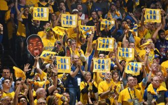 OAKLAND, CA - JUNE 13: Golden State Warriors fans hold up signs and towels during Game Six of the NBA Finals against the Toronto Raptors on June 13, 2019 at ORACLE Arena in Oakland, California. NOTE TO USER: User expressly acknowledges and agrees that, by downloading and/or using this photograph, user is consenting to the terms and conditions of Getty Images License Agreement. Mandatory Copyright Notice: Copyright 2019 NBAE (Photo by Andrew D. Bernstein/NBAE via Getty Images)