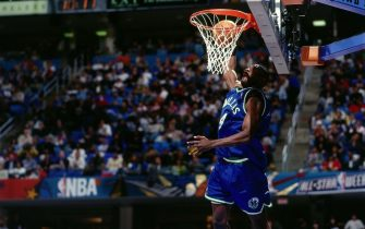 CLEVELAND - FEBRUARY 8:  Michael Finley #4 of the Dallas Mavericks soars for a dunk during the 1997 Nestle Crunch Slam Dunk Contest on February 8, 1997 at the Gund Arena in Cleveland, Ohio. NOTE TO USER: User expressly acknowledges that, by downloading and or using this photograph, User is consenting to the terms and conditions of the Getty Images License agreement. Mandatory Copyright Notice: Copyright 1997 NBAE (Photo by Andrew D. Bernstein/NBAE via Getty Images)