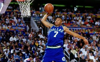 PHOENIX - FEBRUARY 11:  Tony Dumas #7 of the Dallas Mavericks attempts a dunk during the 1995 Slam Dunk Contest on February 11, 1995 at the America West Arena in Phoenix, Arizona.   NOTE TO USER: User expressly acknowledges that, by downloading and or using this photograph, User is consenting to the terms and conditions of the Getty Images License agreement. Mandatory Copyright Notice: Copyright 1995 NBAE (Photo by Nathaniel S Butler/NBAE via Getty Images)