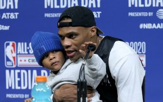 CHICAGO, ILLINOIS - FEBRUARY 15: Russell Westbrook #0 of Team Lebron speaks to the media with his son Noah during 2020 NBA All-Star - Practice & Media Day at Wintrust Arena on February 15, 2020 in Chicago, Illinois. NOTE TO USER: User expressly acknowledges and agrees that, by downloading and or using this photograph, User is consenting to the terms and conditions of the Getty Images License Agreement. (Photo by Dylan Buell/Getty Images)