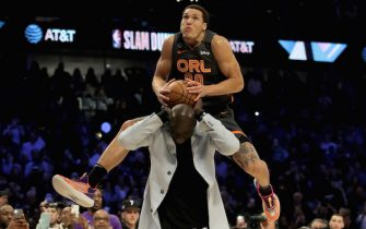 CHICAGO, ILLINOIS - FEBRUARY 15: Aaron Gordon #00 of the Orlando Magic dunks the ball over Tacko Fall of the Boston Celtics in the 2020 NBA All-Star - AT&T Slam Dunk Contest during State Farm All-Star Saturday Night at the United Center on February 15, 2020 in Chicago, Illinois. NOTE TO USER: User expressly acknowledges and agrees that, by downloading and or using this photograph, User is consenting to the terms and conditions of the Getty Images License Agreement. (Photo by Jonathan Daniel/Getty Images)