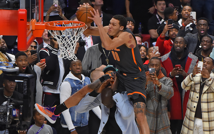 CHICAGO, IL - FEBRUARY 15: Aaron Gordon #00 of the Orlando Magic dunks the ball over Tacko Fall #99 of the Boston Celtics during the AT&T Slam Dunk as part of 2020 NBA All-Star Weekend on February 15, 2020 at United Center in Chicago, Illinois. NOTE TO USER: User expressly acknowledges and agrees that, by downloading and/or using this Photograph, user is consenting to the terms and conditions of the Getty Images License Agreement. Mandatory Copyright Notice: Copyright 2020 NBAE (Photo by Bill Baptist/NBAE via Getty Images)