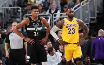MILWAUKEE, WI - DECEMBER 19: Giannis Antetokounmpo #34 of the Milwaukee Bucks and LeBron James #23 of the Los Angeles Lakers look on during a game on December 19, 2019 at the Fiserv Forum Center in Milwaukee, Wisconsin. NOTE TO USER: User expressly acknowledges and agrees that, by downloading and or using this Photograph, user is consenting to the terms and conditions of the Getty Images License Agreement. Mandatory Copyright Notice: Copyright 2019 NBAE (Photo by Joe Murphy/NBAE via Getty Images).