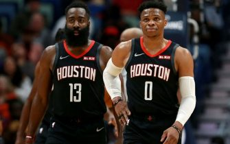 NEW ORLEANS, LOUISIANA - NOVEMBER 11: James Harden #13 of the Houston Rockets and Russell Westbrook #0 of the Houston Rockets stand on the court during a NBA game against the New Orleans Pelicans  at the Smoothie King Center on November 11, 2019 in New Orleans, Louisiana. NOTE TO USER: User expressly acknowledges and agrees that, by downloading and or using this photograph, User is consenting to the terms and conditions of the Getty Images License Agreement. (Photo by Sean Gardner/Getty Images)