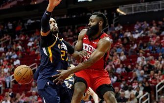 HOUSTON, TEXAS - FEBRUARY 09: James Harden #13 of the Houston Rockets passes the ball defended by Rudy Gobert #27 of the Utah Jazz in the second half at Toyota Center on February 09, 2020 in Houston, Texas.  NOTE TO USER: User expressly acknowledges and agrees that, by downloading and or using this photograph, User is consenting to the terms and conditions of the Getty Images License Agreement. (Photo by Tim Warner/Getty Images)