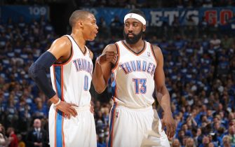 OKLAHOMA CITY, OK - MAY 21:  Oklahoma City Thunder point guard Russell Westbrook #0 and Oklahoma City Thunder guard James Harden #13 confer during a play against the Dallas Mavericks during Game Three of the Western Conference Finals in the 2011 NBA Playoffs on May 21, 2011 at Oklahoma City Arena in Oklahoma City, Oklahoma.  The Maverics won 93-87. NOTE TO USER: User expressly acknowledges and agrees that, by downloading and or using this photograph, User is consenting to the terms and conditions of the Getty Images License Agreement. Mandatory Copyright Notice: Copyright 2011 NBAE  (Photo by Joe Murphy/NBAE via Getty Images)
