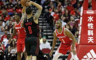 HOUSTON, TX - APRIL 05:  Chris Paul #3 of the Houston Rockets defends Shabazz Napier #6 of the Portland Trail Blazers in the second half at Toyota Center on April 5, 2018 in Houston, Texas.  NOTE TO USER: User expressly acknowledges and agrees that, by downloading and or using this Photograph, user is consenting to the terms and conditions of the Getty Images License Agreement.  (Photo by Tim Warner/Getty Images)
