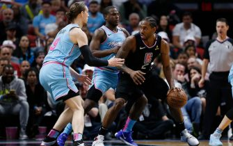 MIAMI, FLORIDA - JANUARY 24:  Kawhi Leonard #2 of the LA Clippers is defended by Dion Waiters #11 and Kelly Olynyk #9 of the Miami Heat during the second half at American Airlines Arena on January 24, 2020 in Miami, Florida. NOTE TO USER: User expressly acknowledges and agrees that, by downloading and/or using this photograph, user is consenting to the terms and conditions of the Getty Images License Agreement.  (Photo by Michael Reaves/Getty Images)