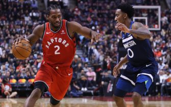 TORONTO, ON - OCTOBER 24:  Kawhi Leonard #2 of the Toronto Raptors dribbles the ball as Jeff Teague #0 of the Minnesota Timberwolves defends during the second half of an NBA game at Scotiabank Arena on October 24, 2018 in Toronto, Canada.  NOTE TO USER: User expressly acknowledges and agrees that, by downloading and or using this photograph, User is consenting to the terms and conditions of the Getty Images License Agreement.  (Photo by Vaughn Ridley/Getty Images)