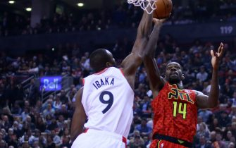 TORONTO, ON - JANUARY 8:  Dewayne Dedmon #14 of the Atlanta Hawks shoots the ball as Serge Ibaka #9 of the Toronto Raptors defends during the first half of an NBA game at Scotiabank Arena on January 8, 2019 in Toronto, Canada.  NOTE TO USER: User expressly acknowledges and agrees that, by downloading and or using this photograph, User is consenting to the terms and conditions of the Getty Images License Agreement.  (Photo by Vaughn Ridley/Getty Images)