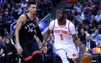 TORONTO, ON - MARCH 18:  Emmanuel Mudiay #1 of the New York Knicks dribbles the ball as Danny Green #14 of the Toronto Raptors defends during the first half of an NBA game at Scotiabank Arena on March 18, 2019 in Toronto, Canada.  NOTE TO USER: User expressly acknowledges and agrees that, by downloading and or using this photograph, User is consenting to the terms and conditions of the Getty Images License Agreement.  (Photo by Vaughn Ridley/Getty Images)