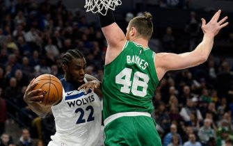 MINNEAPOLIS, MN - MARCH 08: Andrew Wiggins #22 of the Minnesota Timberwolves passes the ball away from Aron Baynes #46 of the Boston Celtics during the game on March 8, 2018 at the Target Center in Minneapolis, Minnesota. NOTE TO USER: User expressly acknowledges and agrees that, by downloading and or using this Photograph, user is consenting to the terms and conditions of the Getty Images License Agreement. (Photo by Hannah Foslien/Getty Images)