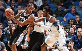 MINNEAPOLIS, MN - DECEMBER 6:  Kawhi Leonard #2 of the San Antonio Spurs handles the ball against Andrew Wiggins #22 of the Minnesota Timberwolves during a game on December 6, 2016 at the Target Center in Minneapolis, Minnesota. NOTE TO USER: User expressly acknowledges and agrees that, by downloading and/or using this photograph, user is consenting to the terms and conditions of the Getty Images License Agreement. Mandatory Copyright Notice: Copyright 2016 NBAE (Photo by David Sherman/NBAE via Getty Images)