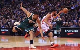TORONTO, ON - DECEMBER 12:  Jabari Parker #12 of the Milwaukee Bucks is beaten to the ball by Cory Joseph #6 of the Toronto Raptors during the first half of an NBA game at Air Canada Centre on December 12, 2016 in Toronto, Canada.  NOTE TO USER: User expressly acknowledges and agrees that, by downloading and or using this photograph, User is consenting to the terms and conditions of the Getty Images License Agreement.  (Photo by Vaughn Ridley/Getty Images)
