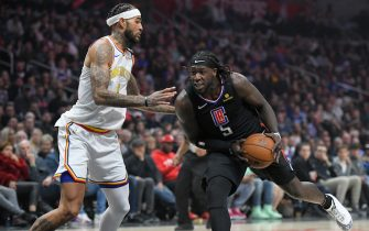 LOS ANGELES, CA - JANUARY 10: Willie Cauley-Stein #2 of the Golden State Warriors guards Montrezl Harrell #5 of the LA Clippers in the second half at Staples Center on January 10, 2020 in Los Angeles, California. NOTE TO USER: User expressly acknowledges and agrees that, by downloading and/or using this photograph, user is consenting to the terms and conditions of the Getty Images License Agreement. (Photo by John McCoy/Getty Images)