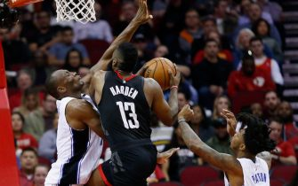 HOUSTON, TX - JANUARY 30:  James Harden #13 of the Houston Rockets drives to the basket on Bismack Biyombo #11 of the Orlando Magic as Elfrid Payton #2 looks on at Toyota Center on January 30, 2018 in Houston, Texas. NOTE TO USER: User expressly acknowledges and agrees that, by downloading and or using this photograph, User is consenting to the terms and conditions of the Getty Images License Agreement.  (Photo by Bob Levey/Getty Images)