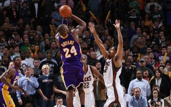 MILWAUKEE - DECEMBER 16:  Kobe Bryant #24 of the Los Angeles Lakers shoots a buzzer-beating jumpshot against Charlie Bell #42 of the Milwaukee Bucks to win the game 106-105 in overtime on December 16, 2009 at the Bradley Center in Milwaukee, Wisconsin.  NOTE TO USER:  User expressly acknowledges and agrees that, by downloading and or using this photograph, User is consenting to the terms and conditions of the Getty Images License Agreement.  Mandatory Copyright Notice:  Copyright 2009 NBAE (Photo by Gary Dineen/NBAE via Getty Images)