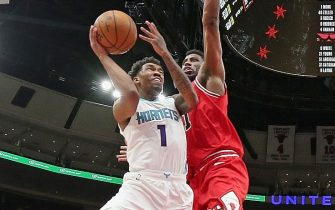 CHICAGO, ILLINOIS - FEBRUARY 20: Malik Monk #1 of the Charlotte Hornets shoots against Thaddeus Young #21 of the Chicago Bulls at the United Center on February 20, 2020 in Chicago, Illinois. The Hornets defeated the Bulls 103-93. NOTE TO USER: User expressly acknowledges and agrees that, by downloading and or using this photograph, User is consenting to the terms and conditions of the Getty Images License Agreement. (Photo by Jonathan Daniel/Getty Images)