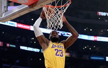 LOS ANGELES, CALIFORNIA - FEBRUARY 21:  LeBron James #23 of the Los Angeles Lakers dunks in front of Dillon Brooks #24 of the Memphis Grizzlies during the first quarter at Staples Center on February 21, 2020 in Los Angeles, California.  NOTE TO USER: User expressly acknowledges and agrees that, by downloading and or using this photograph, User is consenting to the terms and conditions of the Getty Images License Agreement. (Photo by Harry How/Getty Images)