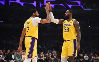 LOS ANGELES, CA - FEBRUARY 21:  Anthony Davis #3 of the Los Angeles Lakers and LeBron James #23 of the Los Angeles Lakers high-five during game against the Memphis Grizzlies on February 21, 2020 at STAPLES Center in Los Angeles, California. NOTE TO USER: User expressly acknowledges and agrees that, by downloading and/or using this Photograph, user is consenting to the terms and conditions of the Getty Images License Agreement. Mandatory Copyright Notice: Copyright 2020 NBAE (Photo by Adam Pantozzi/NBAE via Getty Images)