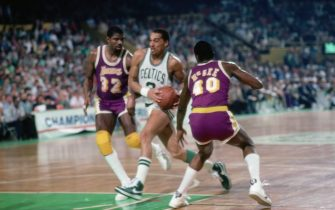 BOSTON - MAY 27:  Dennis Johnson #3 of the Boston Celtics drives to the basket between Magic Johnson #32 and Mike McGee #40 of the Los Angeles Lakers in Game One of the 1985 NBA Finals played on May 27, 1985 at Boston Garden in Boston, Massachusetts. Boston won 148-114. NOTE TO USER: User expressly acknowledges that, by downloading and or using this photograph, User is consenting to the terms and conditions of the Getty Images License agreement. Mandatory Copyright Notice: Copyright 1985 NBAE (Photo by Dick Raphael/NBAE via Getty Images)