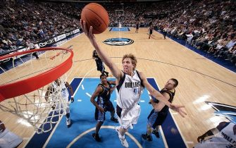DALLAS - DECEMBER 9:  Dirk Nowitzki #41 of the Dallas Mavericks goes in for the layup against the Denver Nuggets on December 9, 2006 at the American Airlines Center in Dallas, Texas. NOTE TO USER: User expressly acknowledges and agrees that, by downloading and/or using this Photograph, user is consenting to the terms and conditions of the Getty Images License Agreement. Mandatory Copyright Notice: Copyright 2006 NBAE  (Photo by Glenn James/NBAE via Getty Images)