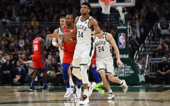 MILWAUKEE, WISCONSIN - FEBRUARY 22:  Giannis Antetokounmpo #34 of the Milwaukee Bucks reacts to a three point shot during the second half of a game against the Philadelphia 76ers at Fiserv Forum on February 22, 2020 in Milwaukee, Wisconsin. NOTE TO USER: User expressly acknowledges and agrees that, by downloading and or using this photograph, User is consenting to the terms and conditions of the Getty Images License Agreement.  (Photo by Stacy Revere/Getty Images)