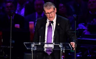 "US-Italian basketball coach Geno Auriemma speaks during the ""Celebration of Life for Kobe and Gianna Bryant"" service at Staples Center in Downtown Los Angeles on February 24, 2020. - Kobe Bryant, 41, and 13-year-old Gianna were among nine people killed in a helicopter crash in the rugged hills west of Los Angeles on January 26. (Photo by Frederic J. BROWN / AFP) (Photo by FREDERIC J. BROWN/AFP via Getty Images)"