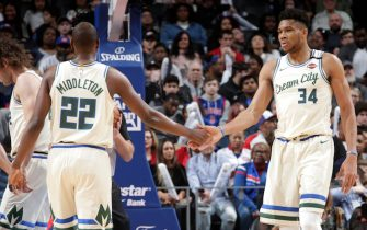 DETROIT, MI - FEBRUARY 20: Khris Middleton #22 of the Milwaukee Bucks high-fives Giannis Antetokounmpo #34 of the Milwaukee Bucks against the Detroit Pistons on February 20, 2020 at Little Caesars Arena in Detroit, Michigan. NOTE TO USER: User expressly acknowledges and agrees that, by downloading and/or using this photograph, User is consenting to the terms and conditions of the Getty Images License Agreement. Mandatory Copyright Notice: Copyright 2020 NBAE (Photo by Brian Sevald/NBAE via Getty Images)
