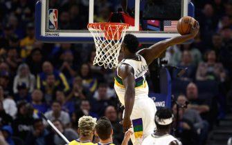 SAN FRANCISCO, CALIFORNIA - FEBRUARY 23:  Zion Williamson #1 of the New Orleans Pelicans goes up for a dunk against the Golden State Warriors at Chase Center on February 23, 2020 in San Francisco, California. NOTE TO USER: User expressly acknowledges and agrees that, by downloading and or using this photograph, User is consenting to the terms and conditions of the Getty Images License Agreement.  (Photo by Ezra Shaw/Getty Images)
