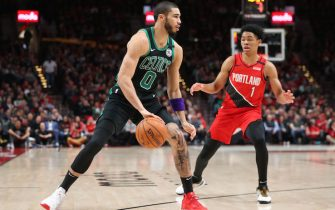 PORTLAND, OREGON - FEBRUARY 25: Jayson Tatum #0 of the Boston Celtics dribbles with the ball against Anfernee Simons #1 of the Portland Trail Blazers in the second quarter during their game at Moda Center on February 25, 2020 in Portland, Oregon. NOTE TO USER: User expressly acknowledges and agrees that, by downloading and or using this photograph, User is consenting to the terms and conditions of the Getty Images License Agreement. (Photo by Abbie Parr/Getty Images)
