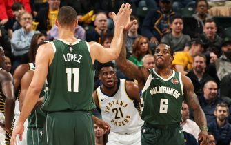 INDIANA, IN - DECEMBER 12:  Brook Lopez #11 hi-fives Eric Bledsoe #6 of the Milwaukee Bucks on December 12, 2018 at the Bankers Life Fieldhouse in Indianapolis, Indiana. NOTE TO USER: User expressly acknowledges and agrees that, by downloading and or using this Photograph, user is consenting to the terms and conditions of the Getty Images License Agreement. Mandatory Copyright Notice: Copyright 2018 NBAE (Photo by Gary Dineen/NBAE via Getty Images)
