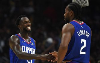 LOS ANGELES, CALIFORNIA - OCTOBER 22:   Patrick Beverley #21 of the LA Clippers laughs with Kawhi Leonard #2 leading the Los Angeles Lakers during the fourth quarter in a 112-102 Clippers win in the LA Clippers season home opener at Staples Center on October 22, 2019 in Los Angeles, California. (Photo by Harry How/Getty Images)