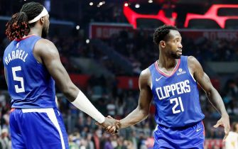 LOS ANGELES, CA - NOVEMBER 3: Montrezl Harrell #5, and Patrick Beverley #21 of the LA Clippers hi-five each other against the Utah Jazz on November 3, 2019 at STAPLES Center in Los Angeles, California. NOTE TO USER: User expressly acknowledges and agrees that, by downloading and/or using this Photograph, user is consenting to the terms and conditions of the Getty Images License Agreement. Mandatory Copyright Notice: Copyright 2019 NBAE (Photo by Chris Elise/NBAE via Getty Images)