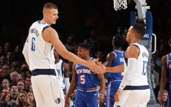 NEW YORK, NY - NOVEMBER 14: Kristaps Porzingis #6, and Jalen Brunson #13 of the Dallas Mavericks hi-five each other against the New York Knicks on November 14, 2019 at Madison Square Garden in New York City, New York.  NOTE TO USER: User expressly acknowledges and agrees that, by downloading and or using this photograph, User is consenting to the terms and conditions of the Getty Images License Agreement. Mandatory Copyright Notice: Copyright 2019 NBAE  (Photo by Nathaniel S. Butler/NBAE via Getty Images)