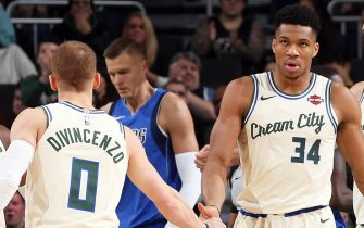 MILWAUKEE, WI - DECEMBER 16: Giannis Antetokounmpo #34 of the Milwaukee Bucks high fives Donte DiVincenzo #0 during the game against the Dallas Mavericks on December 16, 2019 at the Fiserv Forum Center in Milwaukee, Wisconsin. NOTE TO USER: User expressly acknowledges and agrees that, by downloading and or using this Photograph, user is consenting to the terms and conditions of the Getty Images License Agreement. Mandatory Copyright Notice: Copyright 2019 NBAE (Photo by Gary Dineen/NBAE via Getty Images).