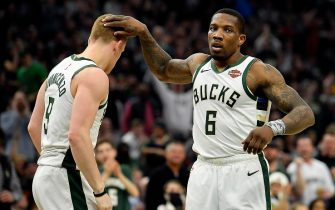 MILWAUKEE, WISCONSIN - MARCH 09: Eric Bledsoe #6 of the Milwaukee Bucks celebrates the three point basket from Donte DiVincenzo #9 of the Milwaukee Bucks against the Charlotte Hornets at Fiserv Forum on March 09, 2019 in Milwaukee, Wisconsin.  NOTE TO USER: User expressly acknowledges and agrees that, by downloading and or using this photograph, User is consenting to the terms and conditions of the Getty Images License Agreement.  (Photo by Quinn Harris/Getty Images)