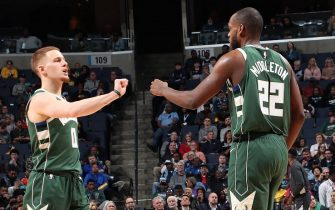 MEMPHIS, TN - DECEMBER 13: Donte DiVincenzo #0, and Khris Middleton #22 of the Milwaukee Bucks fist pump each other during the game against the Memphis Grizzlies on December 13, 2019 at FedExForum in Memphis, Tennessee. NOTE TO USER: User expressly acknowledges and agrees that, by downloading and or using this photograph, User is consenting to the terms and conditions of the Getty Images License Agreement. Mandatory Copyright Notice: Copyright 2019 NBAE (Photo by Joe Murphy/NBAE via Getty Images)