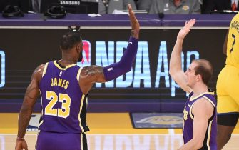 LOS ANGELES, CA - NOVEMBER 13: LeBron James #23 of the Los Angeles Lakers and Alex Caruso #4 of the Los Angeles Lakers high-five during a game against the Golden State Warriors on November 13, 2019 at STAPLES Center in Los Angeles, California. NOTE TO USER: User expressly acknowledges and agrees that, by downloading and/or using this Photograph, user is consenting to the terms and conditions of the Getty Images License Agreement. Mandatory Copyright Notice: Copyright 2019 NBAE (Photo by Adam Pantozzi/NBAE via Getty Images)