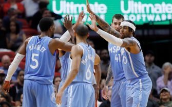 MIAMI, FLORIDA - FEBRUARY 26:  D'Angelo Russell #0 of the Minnesota Timberwolves celebrates with teammates against the Miami Heat during the second half at American Airlines Arena on February 26, 2020 in Miami, Florida. NOTE TO USER: User expressly acknowledges and agrees that, by downloading and/or using this photograph, user is consenting to the terms and conditions of the Getty Images License Agreement.  (Photo by Michael Reaves/Getty Images)