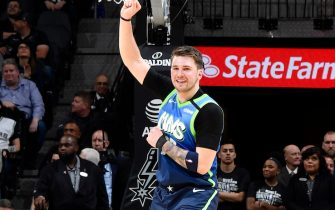 SAN ANTONIO, TX - FEBRUARY 26: Luka Doncic #77 of the Dallas Mavericks reacts to a play during the game against the San Antonio Spurs on February 26, 2020 at the AT&T Center in San Antonio, Texas. NOTE TO USER: User expressly acknowledges and agrees that, by downloading and or using this photograph, user is consenting to the terms and conditions of the Getty Images License Agreement. Mandatory Copyright Notice: Copyright 2020 NBAE (Photos by Logan Riely/NBAE via Getty Images)